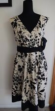 Cue, black,cream dress..floral print...cross over..size 12...excellent condition