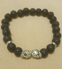 black lava stone and silver skull detail stretch bracelet