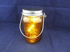 Hanging Metallic LED Light in a Glass Jar - Bronze.
