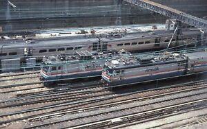 AMTRAK 1992 Kodachrome slide. AEM7 928, 957. Penn Station overhead street view