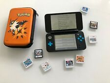 nintendo 2ds xl console with games and case