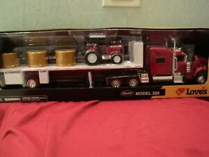 New-Ray  Peterbilt 389  tractor w/ Flatbed trailer  1/32 scale NIB  opening hood