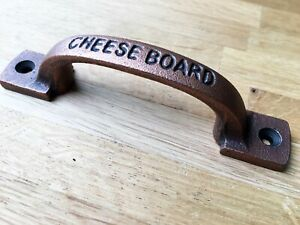 SUPERB CHEESE BOARD CAST IRON HANDLE WITH AGED COPPER FINISH