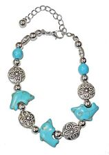 Faux Turquoise Jumping Dolphin Bracelet W/ Silver Beads, By JADA Collections