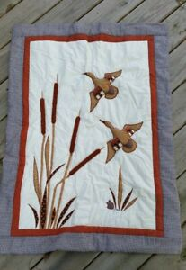 Handmade quilts with ducks