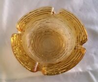 "Mid Century Textured Amber Glass Ashtray 4 1/4"" diameter 4 cigarette slots"