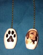 One Rhodesian Ridgeback Dog Fan Pull With Paw Prints On The Back 1""