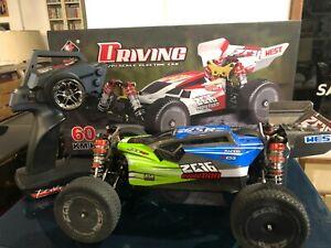 Modellino radiocomandato WL-toys 144001 RC Scala 1/14 Drift Racing Car 4WD