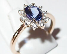 Stunning AA Tanzanite ring, in 14k Yellow Gold with natural Zircon. Size N.