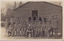 WW1 NCO's and men Royal Fusiliers outside wooden barrack hut