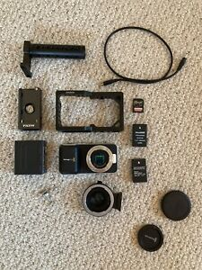 BlackMagic Pocket Cinema Camera With Cage and Speed Booster