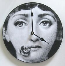 Fornasetti clock. Woman with a flower in her mouth.  Digital image.