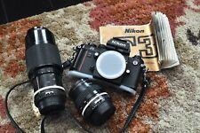 Nikon F3 camera body with two Nikon Nikkor lenses new batteries