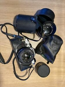 Olympus OM10 With Lens And Converter
