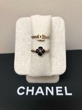 Authentic Chanel Black Enamel/Gold Camellia & Gold CC Logo Ring Set