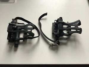 pair of wellgo pedals with toe clip and straps. New so excellent condition