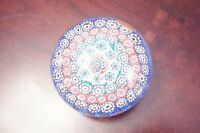 Vintage millefiori glass paperweight.Made on the island of Murano, Italy[8]