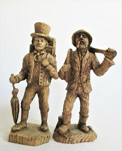 Pair of Carved Wooden Figures of Travellers, a Clockmaker & a Woodsman