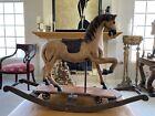 VINTAGE WOOD ROCKING HORSE W  CAST IRON WHEELS LEATHER SADDLE GLASS EYES