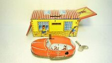 SPECIAL VINTAGE LITTLE TIN GARAGE  WITH WIND UP CAR MADE IN JUGOSLAVIA EX RARE