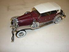 A Franklin mint scale model car of a 1930 Duesenberg  J Durham,  no box,