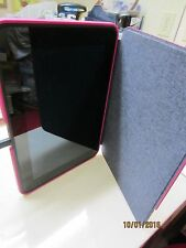 Kindle Fire with pink cover, cord, instruction book