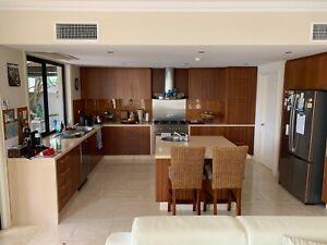 Complete kitchen minus fridge and dishwasher. L shape plus island bench.