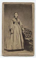 CDV CIVIL WAR ERA PRETTY WOMAN STANDING AT UPHOLSTERED CHAIR.