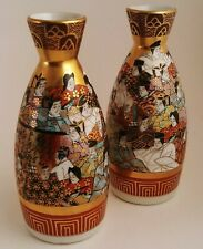 Pair of Porcelain Sake Bottles - Hand Decorated Figures With Gold Accents