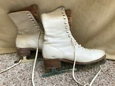 Vintage leather women's ice skates, red plaid lining, US made