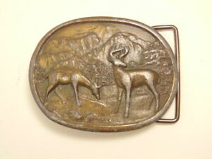 Heavy brass colored buckle showing deer and mountains: Indiana Metal Craft