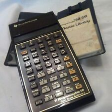 Vintage Texas Instruments TI-58 programmable calculator + master library