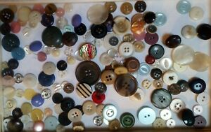 Assorted mixed pastel coloured vintage sewing buttons,black,blue,white, lilac