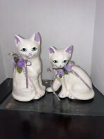 """Pair of Porcelain Sitting Cat Figurines Purple Flower Collar 6"""" And 5"""" Tall"""