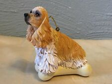 English Cocker Spaniel on a Bone Ornament by Kurt Adler