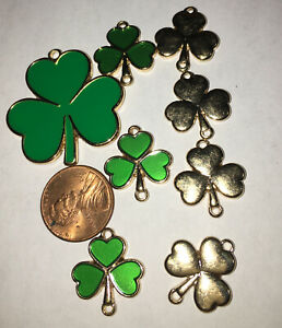 8 Clover Charms gold tone  & green
