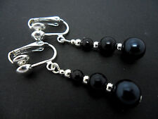 A PAIR OF DANGLY  BLACK GLASS PEARL  SILVER  PLATED CLIP ON EARRINGS.