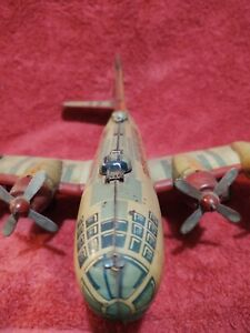 VINTAGE TIN TOY AIRPLANE YONEZAWA  USAF FRICTION BOMBER  AIRPLANE 123567 LITHO
