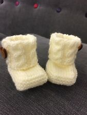 Trendy baby booties. Hand made in cream Acrylic wool with a wooden heart button