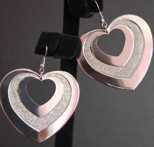 Silver plated heart earrings with glitter detail