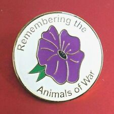 'Remembering the Animals of War' Purple Poppy on white background enamel badge