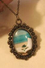Lovely Floral Rimmed Brasstone Stones Waves Serenity Meditation Pendant Necklace