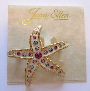 Pin/Brooch -STARFISH-- gold tone- white enamel- pink, yellow & blue stones