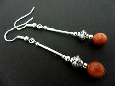 A PAIR OF DANGLY BROWN GOLDSTONE  BEAD  SILVER PLATED EARRINGS.