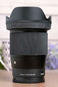 Sigma 16mm f/1.4 DC DN Contemporary Lens for Sony E Mount with Caps and Hood