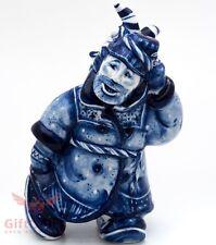 Gzhel porcelain figurine of Russian folk mummer man with a goat mask