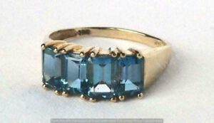 2.50CT Emerald Cut London Blue Topaz Engagement Ring In 14K Yellow Gold Finish