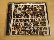 CD / GRAND FUNK RAILROAD - CAUGHT IN THE ACT ( REMASTERED )