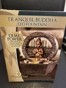 Tranquil Buddha LED Fountain w/ Flowing Water Dual Power Natural River Rocks