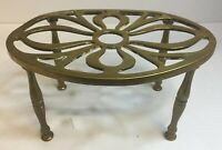 ANTIQUE SOLID BRASS FIRESIDE TRIVET OVAL SHAPED WITH PIERCED TOP AND 4 LEGS